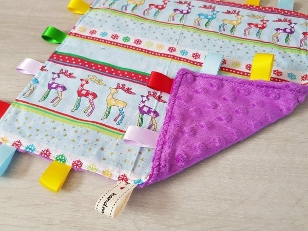 multi colour deers taggie blanket