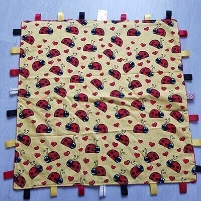 Ladybirds XL taggie blanket