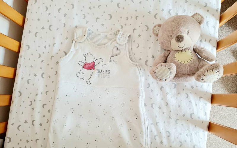 Cot and baby sleeping bag